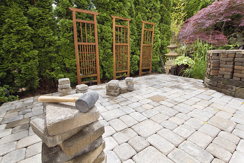 Residential hardscape brick pavers in backyard